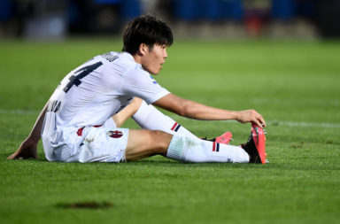 Takehiro Tomiyasu of Bologna FC suffers an injury during the